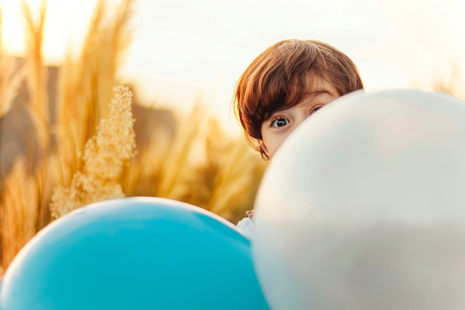 Child Behind Balloons